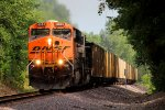 BNSF 6095 leads a loaded ucex coal sb.