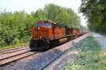 BNSF 7295 leads a empty grain train NB.