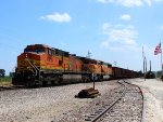 BNSF 4918 leads a empty ore train past old glory.