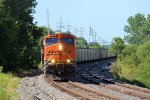BNSF 5884 heads sb with a loaded ucex coal train.