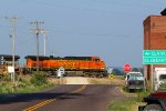BNSF 4162 heads thur small town usa.