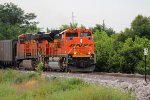 BNSF 9166 leads a empty coal back for the mines,
