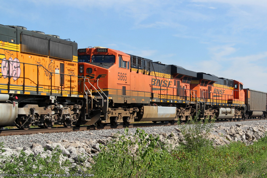 BNSF 5865 and 6150 help this empty coal out.