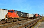 CN DPU passing stopped westbound at Dorval