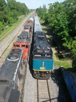 VIA 6413 is hot on the heels of a CN freight