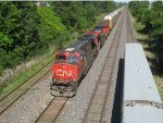 CN 2252, CN 2524 & CN 4809 pass a stopped VIA train