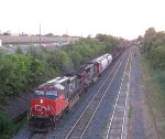 CN 2600 & CN 5758 snake out of Taschereau Yard at sunset