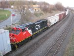 CN 2174 in fairly fresh paint is the DPU on a CN eastbound