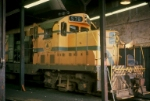 MEC 578, chopnosed GP7, getting some attention in roundhouse,
