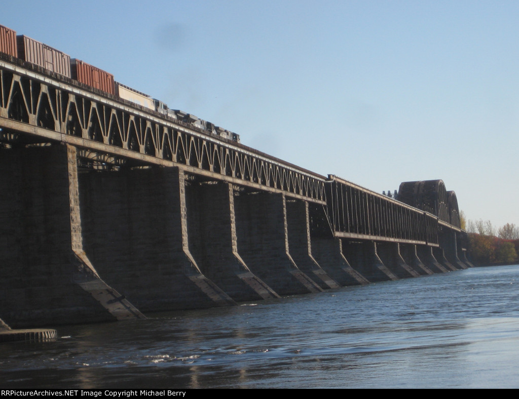 An NS train crosses CPs St-Laurent Railway Bridge as it leaves the island of Montreal