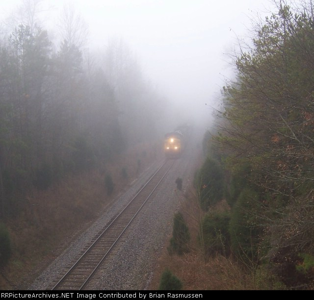 CSX 318, emerging from the fog,