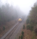 CSX 318 in the fog with eastbound coal