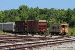 J760 has dropped the caboose to set out a string of boxcars and hoppers