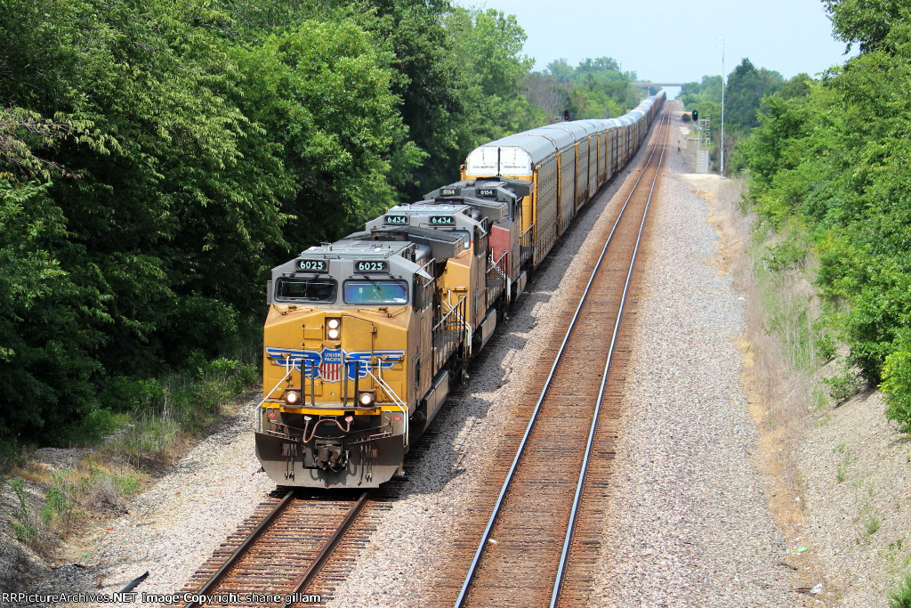 UP 6025 leads a wb string of auto racks.