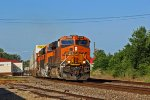 BNSF 6789 Leans into the sun with a hot Z in tow.