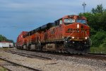 BNSF 7433 heads west with a stack train in tow.