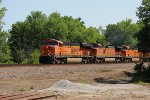 BNSF 7599 leads a wb stack train.