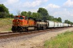 BNSF 4063 heads wb on a mixed freight train.