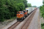 BNSF 7564 leads a wb stack train.