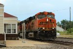 BNSF 7574 leads a wb stack train.