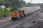 BNSF 4445 leads a eb stack train in a down pour.
