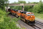 BNSF 7920 rocks a wb stack train in the down pour.