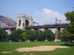 Regional #164 approaches the Hell Gate Bridge's main arch span