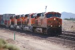 UntitledBNSF 7435 leads 3 Brand New C4's eastward (BNSF 7027, 7024, 7025) as they slow down for a crewchange at BNSF Barstow.