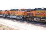BNSF 7027 and the rear of BNSF 7024 follow the lead unit BNSF 7435 into Barstow for a crewswap