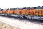 Part of the rear of BNSF 7027 BNSF 7024 and BNSF 7025.