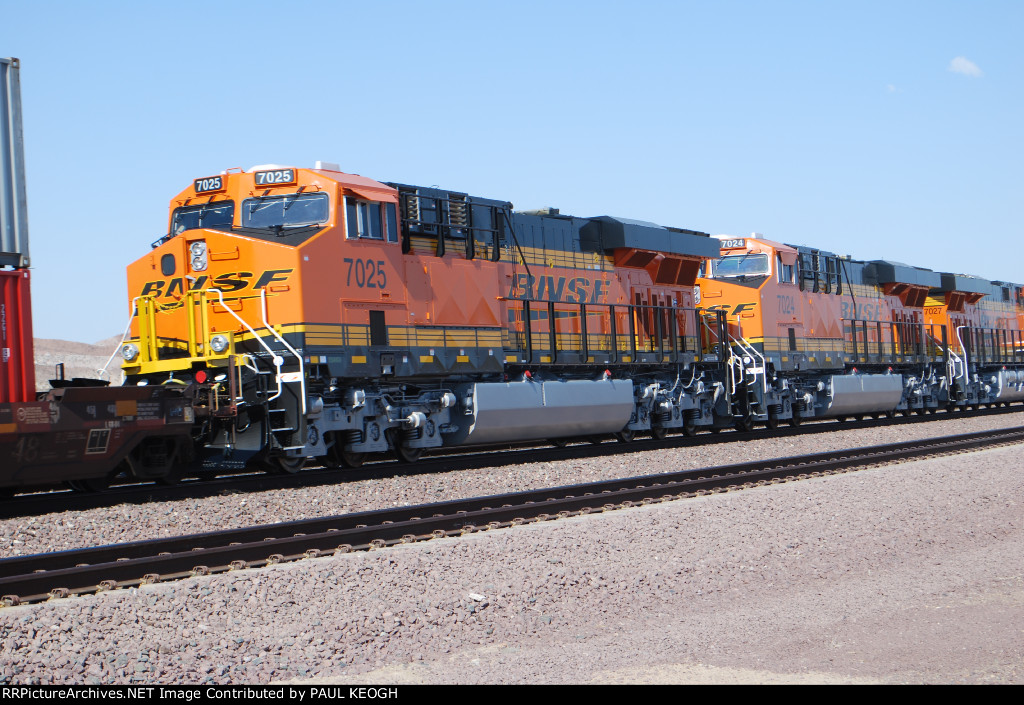 BNSF 7025 and BNSF 7024 with the rear of BNSF 7027.