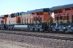BNSF 7024 and the rears of both BNSF 7027 and BNSF 7025.