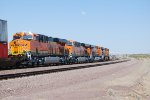 BNSF 7435,BNSF 7027, BNSF 7024 , and BNSF 7025 make the turn towards Daggett, Ca as they lead the S LHA-CLO (La Habra, Ca to Clovis, NM Stack Train) and pick up a High Ball Red to stop at Daggett.