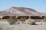BNSF 7027, BNSF 7024,and BNSF 7025 as they slow down for the Red at Daggett, CA.