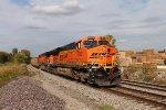 BNSF 6042 heads a sb coal load around mp 52 curve.