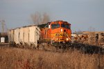 BNSF 4323 is a 1 unit wonder on this long cement train.