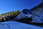 Westbound Cal Zephyr at Yuba Pass.  There was a light snowfall the day before
