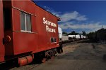 SP Baywindow Caboose on display at Auburn, CA.  U.P. train with Wind blades and generators drifts downgrade to Sacramento