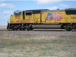 Union Pacific SD70M No. 5221 moving west east of