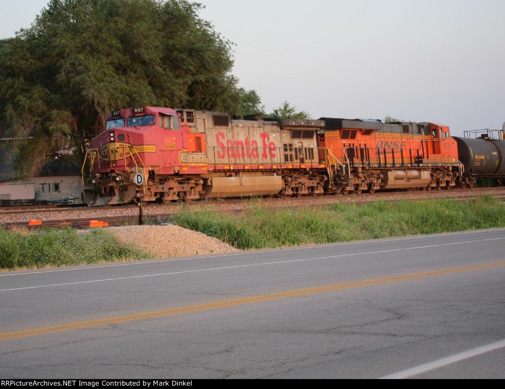 Former Santa Fe C44-9W no. 667 waits with BNSF ES44AC no. 6724 for a southbound coal train