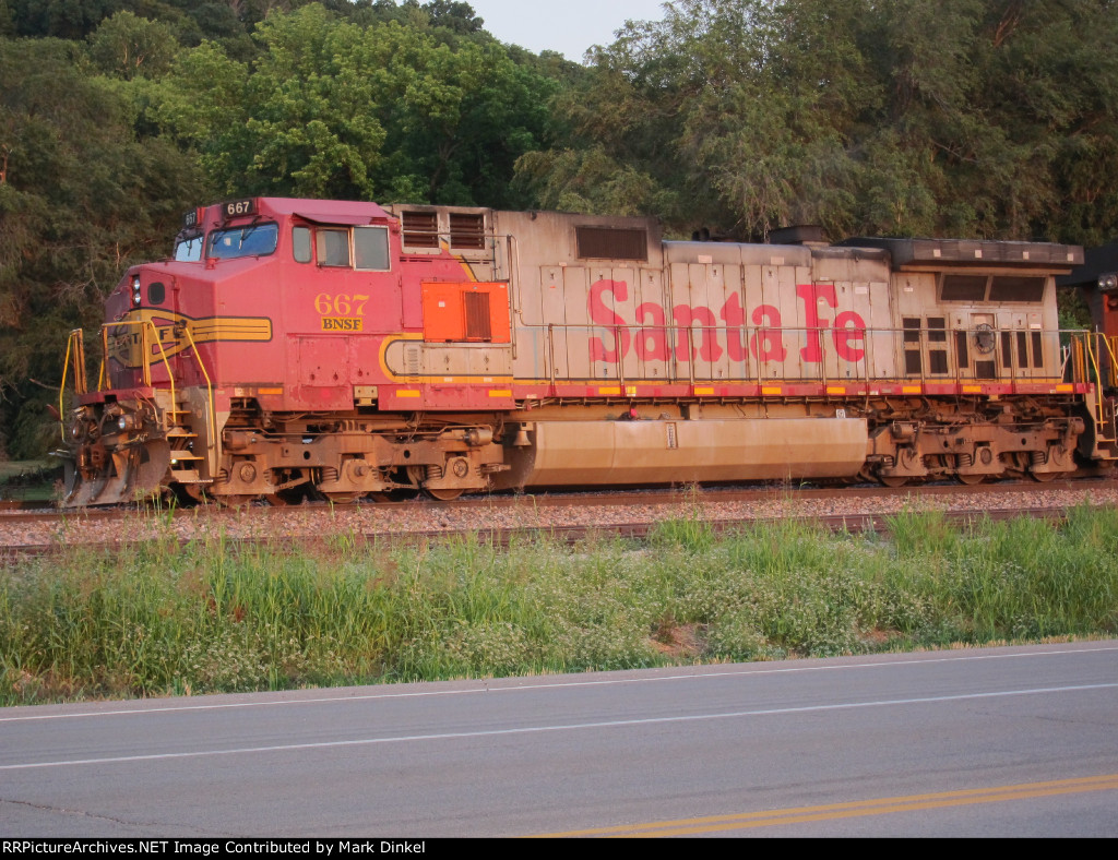 Former Santa Fe C44-9W no. 667 waits for a southbound coal train