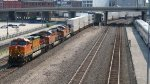 BNSF 4474 Leading a stack with a green signal and Amtrak 455