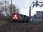 CN 2446 works its way WB/NB with the CSX Q621