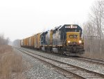 Led by 6954, D700-03 slows for a stop signal at the west end of Wells