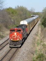 Third in line to go west, M393 picks up speed behind CN 8862 & 5708