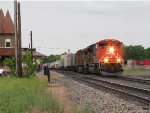 M394 rolls east past the station led by CN 8929