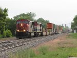 CN 5705 & BCOL 4604 head west at track speed with Q149