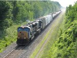 Leaving a dust cloud in its wake, CSX's D710-02 heads east over CN trackage rights