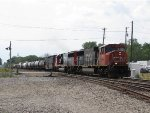 CN 5700 & 5431 roll east at track speed with M396