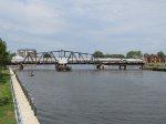 AMTK 84 pushes P371-12 across the St Joe swing bridge